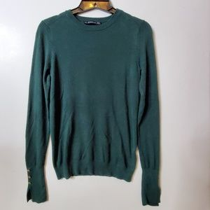 Zara Knit green sweater with gold buttons.
